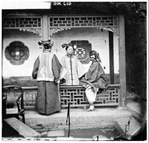 3 women in a courtyard by John Thomson