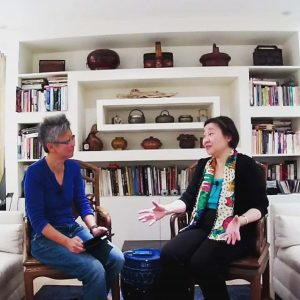 Betty Yao (R) talking to Yang-May (L) about John Thomson's photos of Old China and Siam