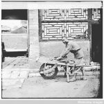 Man with a cart - street scene by John Thomson